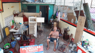 Pedro in his garage. Photo by Frank Correa